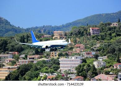 Plane approaching Corfu airport. Corfu island, Ionian Sea, Greece.