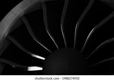 Plane background. Airplane turbine blades close-up. Airplane engine. Turbines blade. Aviation Technologies. Aircraft jet black detail during maintenance. Macro.