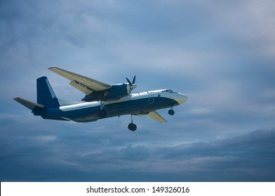 plane in the blue sky with clouds