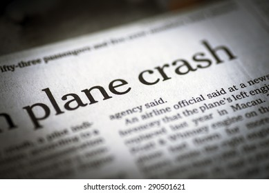 Plane Crash written newspaper; shallow dof; real newspaper.