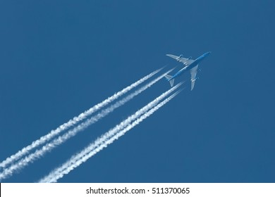 Plane at cruising altitude against blue sky