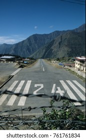A plane departs Runway 24 at Lukla airstrip in the Himalayas, Nepal