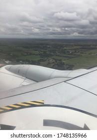 plane engine outside of plane window looking over Australian bush