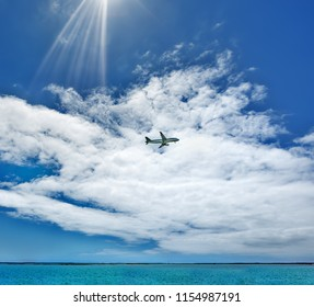 The plane flies near the coast of the city of Faro, Portugal. Over the Atlantic Ocean. Summer sunny day.