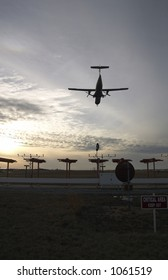 A plane flies out of an airport