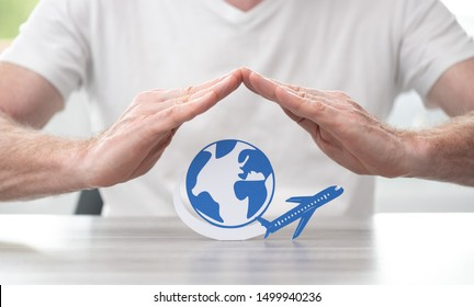 Plane flying around the world protected by hands - Concept of travel insurance