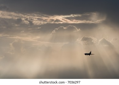A plane flying away in the evening sky