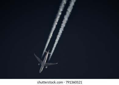 plane flying with a contrail