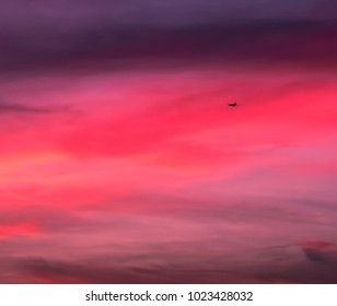 Plane flying into colorful sunset sky-natures photography