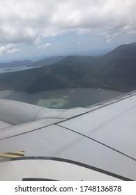 plane flying over the great barrier reef in Port Douglas in Australia