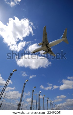 Plane Flying Over Landing Lights Airport Stock Photo (Edit Now