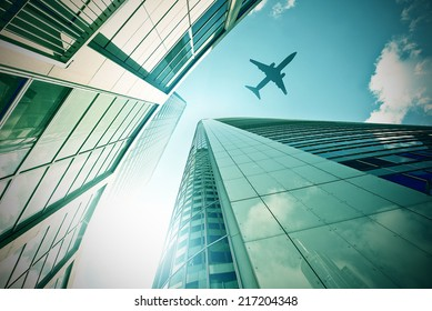plane flying over a modern glass and steeel office towers in Frankfurt am Main, Germany
