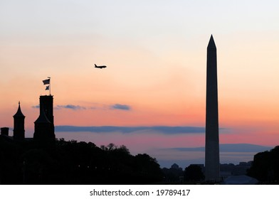 Plane flying over the Smithsonian Institution, the National Mall and Washington Memorial at dusk in downtown Washington DC