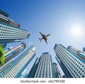 Plane flying in the skies encircled by towering buildings
