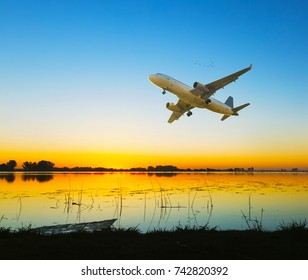 Plane flying in the sky above water with great speed