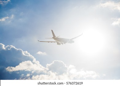 plane flying in the sky, at sunset, in sunshine