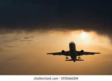 Plane goes on takeoff at sunset