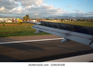 Plane landing in the airport of Majorca, view from airplane window. Spain