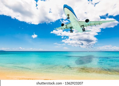 Plane at Maho beach in St Maarten. Travel and air transportation background.