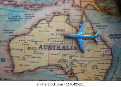 Plane model on Australia part of world map. Flights/ travel in Australia concept.