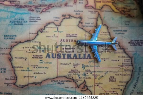 Plane model on Australia part of world map. Flights/ travel in Australia concept.