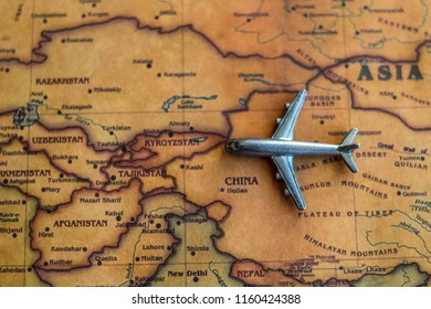 Plane model on China part of world map. Flights/ travel in China concept.
