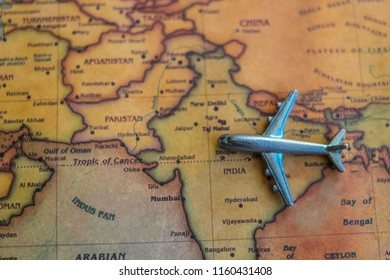 Plane model on India part of world map. Flights/ travel in India concept.
