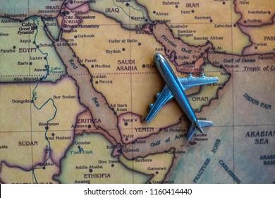 Plane model on Saudi Arabia part of world map. Flights/ travel in Saudi Arabia concept.