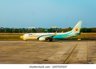 The plane of Nok Air is running on the runway to take off at Udonthani airport , Udonthani province , Thailand.  1 Mar 2018