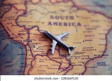 Plane on Bolivia (world map). Flights/ immigration to Bolivia concept.
