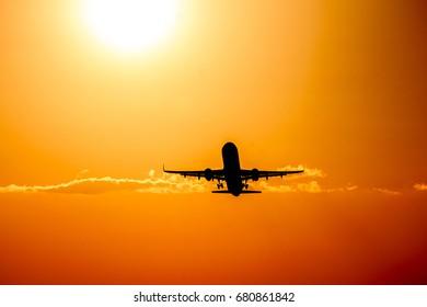 Plane on a bright sunset.