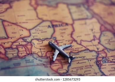 Plane on Nigeria (map). Flights / immigration to Nigeria concept.