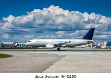 Plane on the runway with a beautiful textured sky
