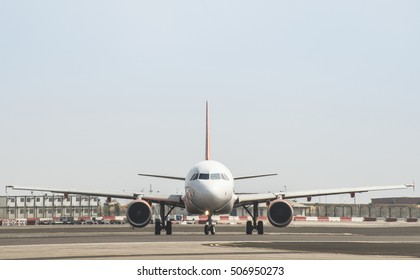 Plane on the runway. Frontal view