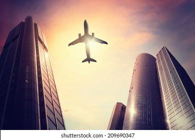 Plane over big city