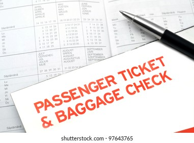 Plane passenger ticket and baggage check on diary planner