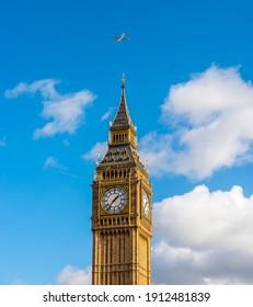 Plane passing over Big Ben, London, England, UK