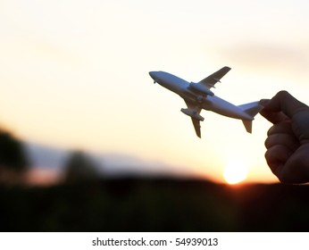plane at sunset