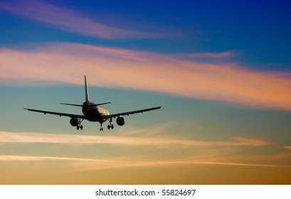 Plane. Sunset