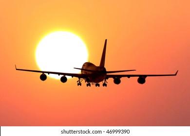 plane take off to sunset
