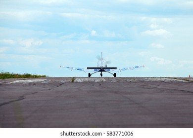 The plane takes off on the runway against the blue sky