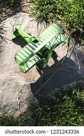 Plane toy in the garden. Sunny day