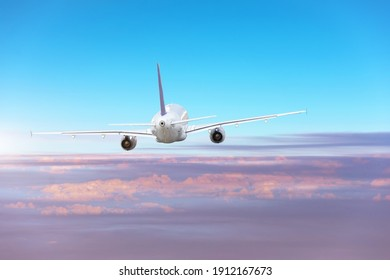 Plane travel, international flight, plane flying in the blue sky above the clouds