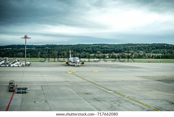 Plane waiting for departure next to the runway