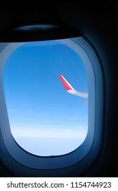 plane window and blue sky