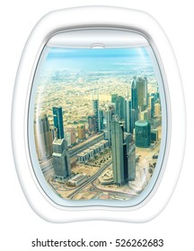 Plane window on skyscrapers of Dubai downtown skyline on Sheikh Zayed Road, United Arab Emirates, from a plane through the porthole. Copy space.