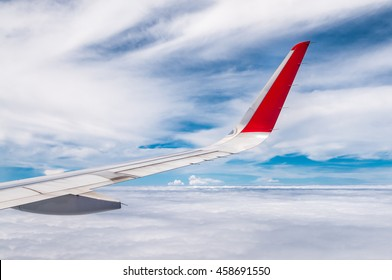 Plane wing on the sky.