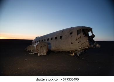 Plane wreck at sunset on Solheimasandur lava beach near Vik in Southern Iceland