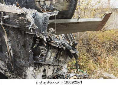 Plane wreckage, parts of the fuselage and tail of the burned and broken aircraft at the dump of non-ferrous scrap metal for recycling.