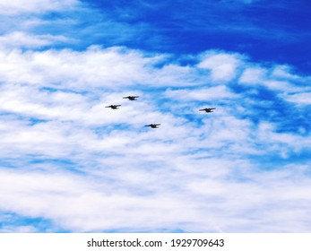Planes flying in formation in a sea of clouds. Four propeller planes of the Spanish air force.
